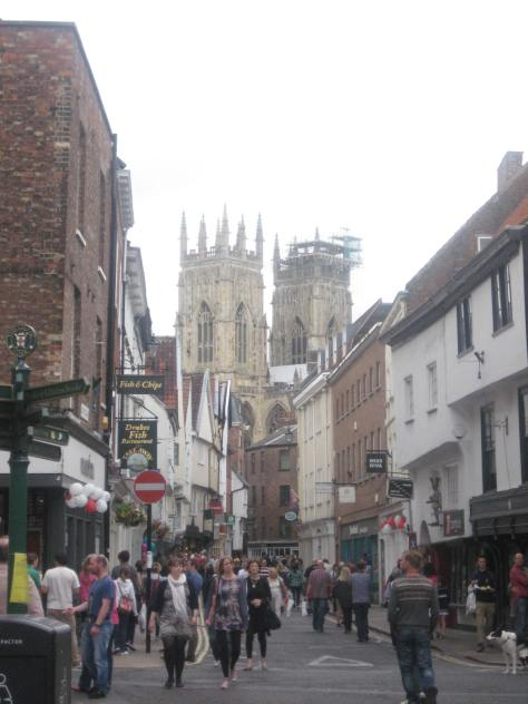 The towers of York Minster loom above Low Petersgate